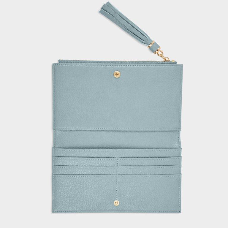 Sophia Tassel Fold Out Purse In Pale Blue