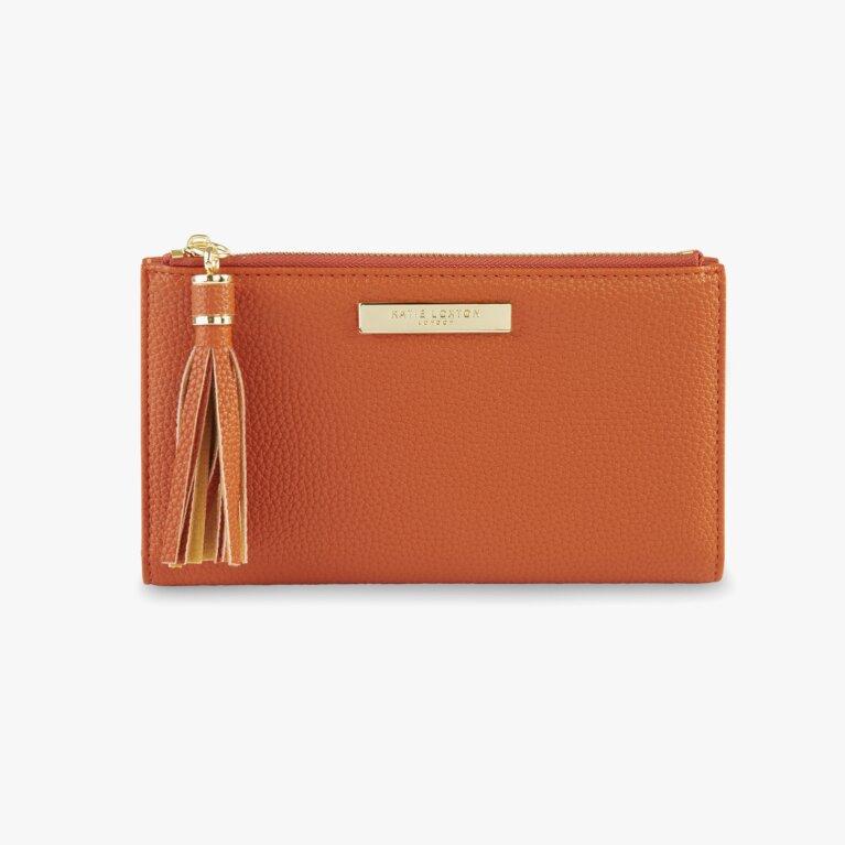 Sophia Tassel Fold Out Purse In Burnt Orange